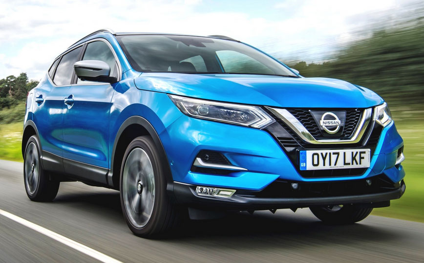 The nissan qashqai driving on the road